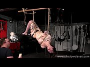 Tattooed suspension bondage of slave Reversa in caning and tit torture hanging in artistic ropes