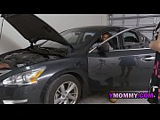 Horny milf blows on the mechanics as they fix her car