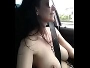 Girl singing in her car topless