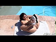 A guy shows his massage skills on a curvy body in this video